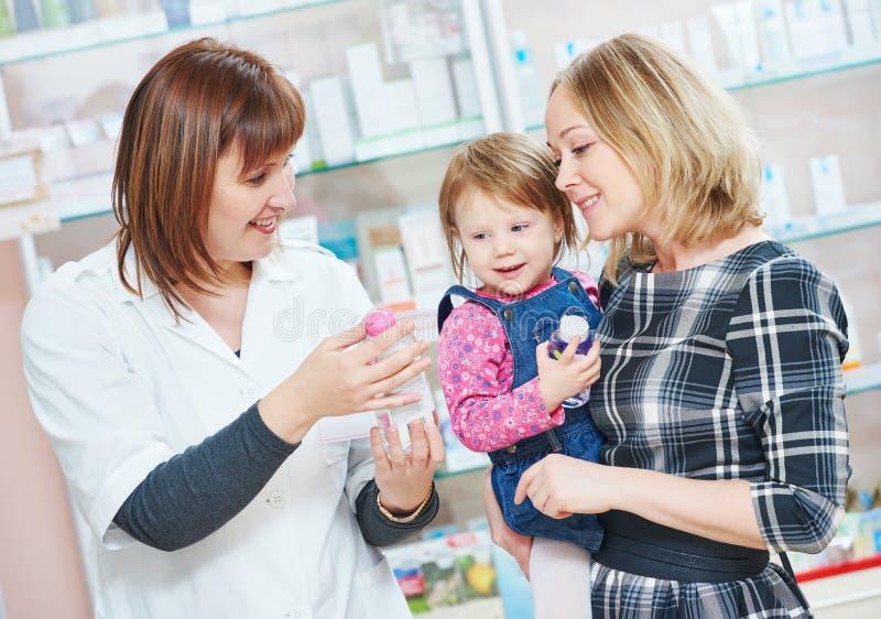 Family in drug store stock image