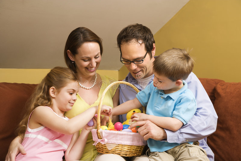 Family with Easter basket. royalty free stock image