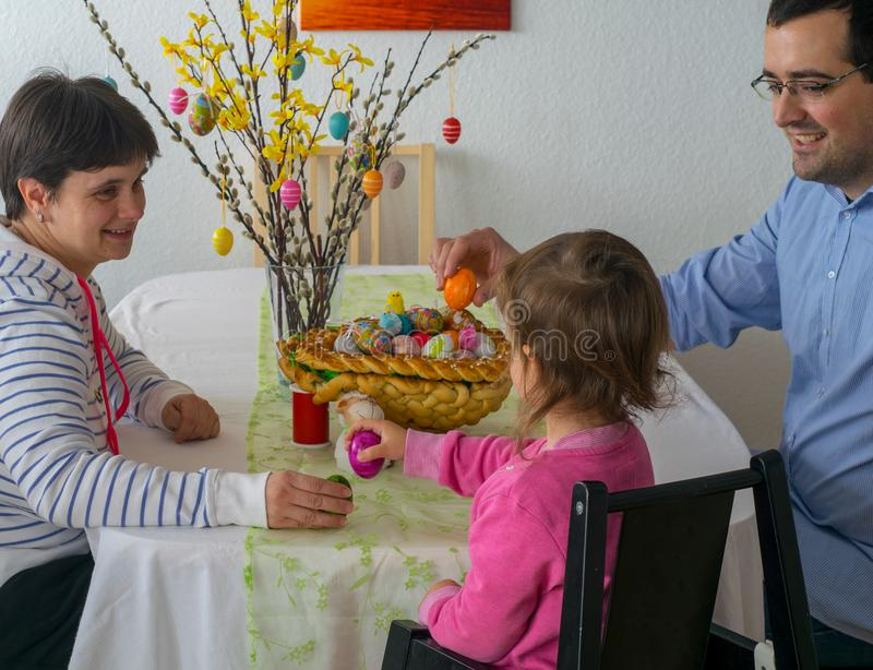 Family at Easter picking eggs royalty free stock images