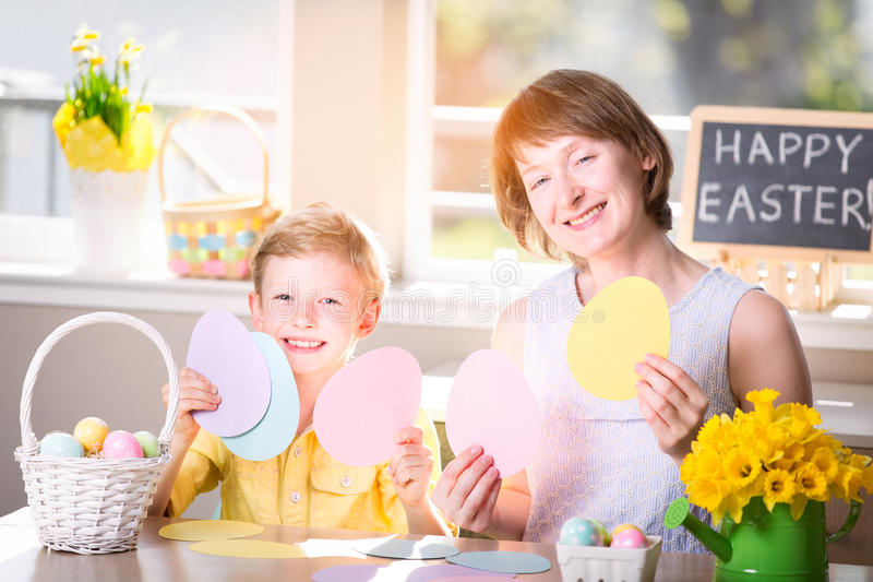 Family at easter. Family of two, mother and her son, celebrating easter time at home with fun activities and easter egg hunt royalty free stock photo
