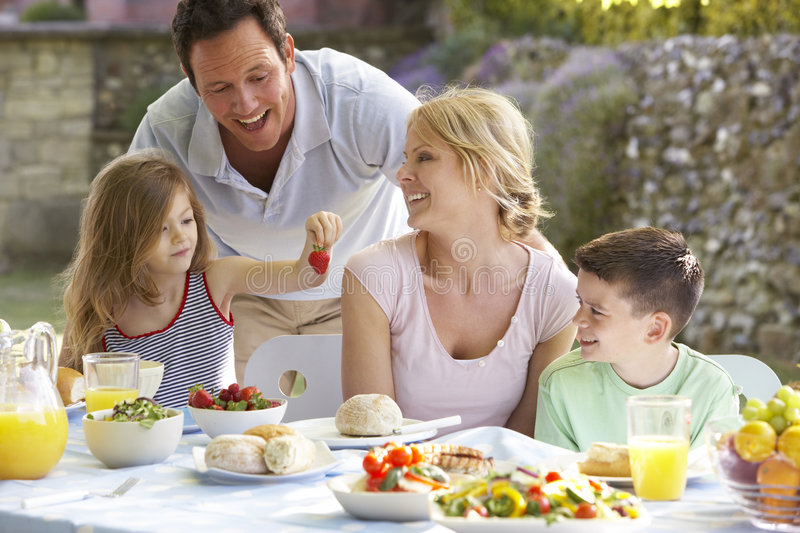 Download Family Eating An Al Fresco Meal Stock Photo - Image: 7869226