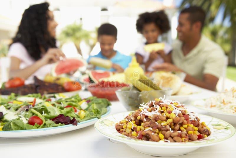 Family Eating An Al Fresco Meal stock photography