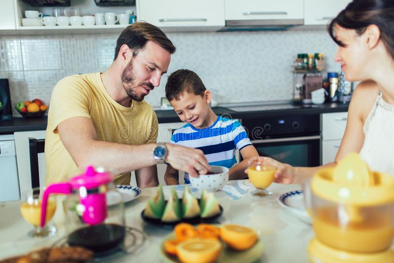 Family Eating Breakfast At Kitchen Table. Having fun stock photos