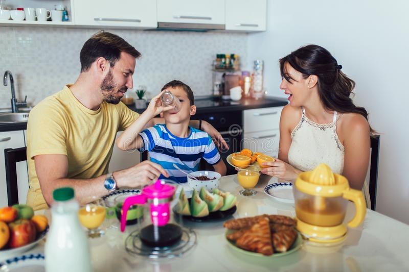 Family Eating Breakfast At Kitchen Table. Having fun stock photo