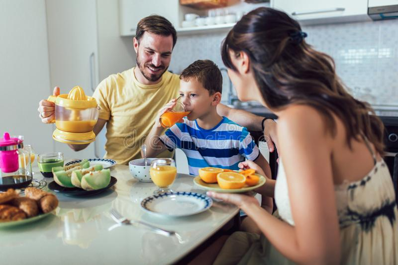 Family Eating Breakfast At Kitchen Table. Having fun stock image
