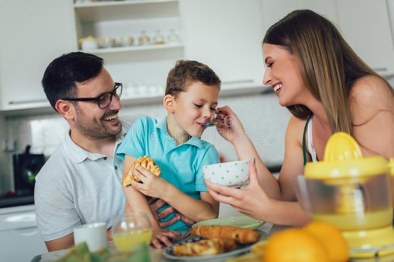 Family Eating Breakfast At Kitchen Table. At home royalty free stock photo