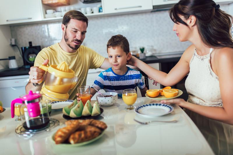 Family Eating Breakfast At Kitchen Table. Having fun royalty free stock photography