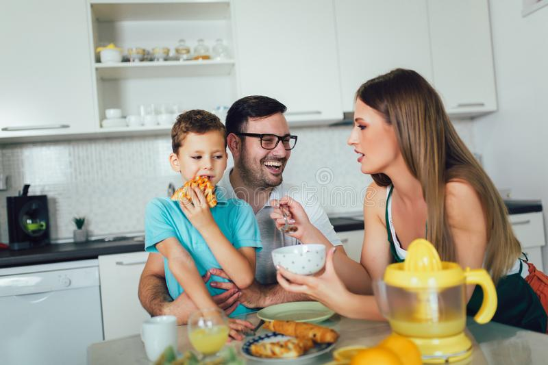 Family Eating Breakfast At Kitchen Table. At home royalty free stock images