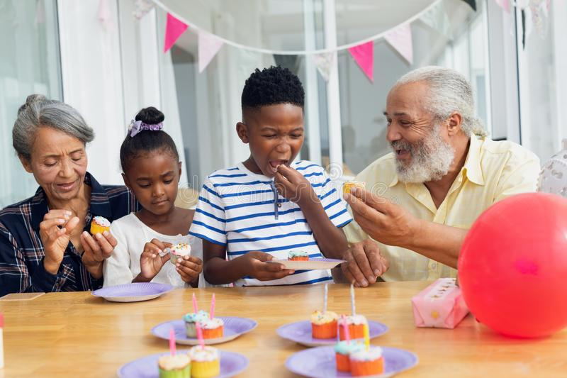 Family eating cupcakes stock image