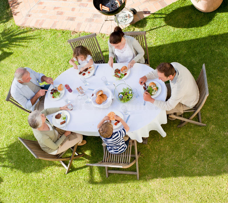 Family eating in the garden stock photo