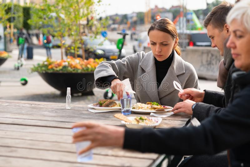 Family eating at an outdoor restaurant royalty free stock image
