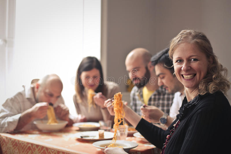 Family eating pasta. Family eating spaghetti at home royalty free stock photography