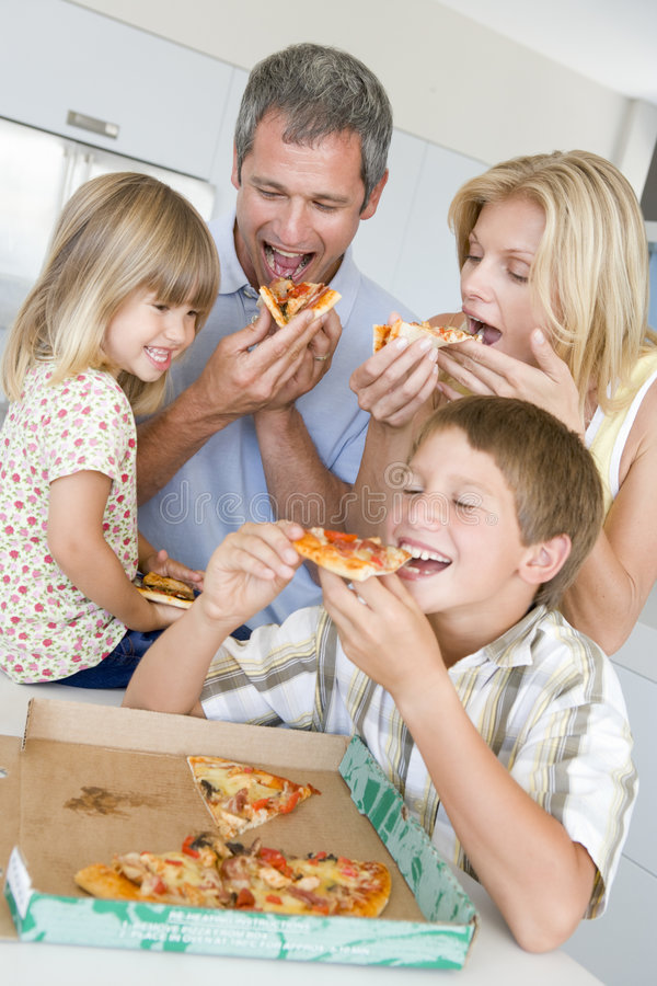 Download Family Eating Pizza Together Royalty Free Stock Photos - Image: 6880278