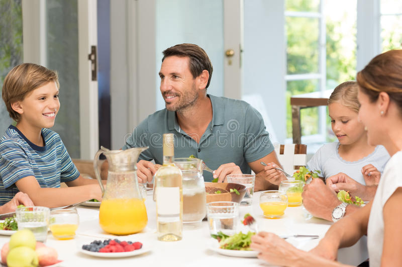Family eating together stock photography