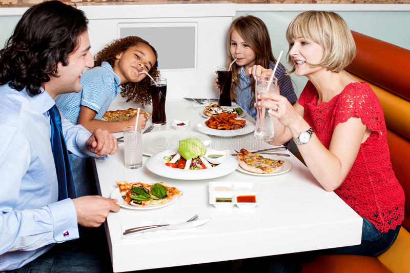 Family eating together in hotel. royalty free stock image