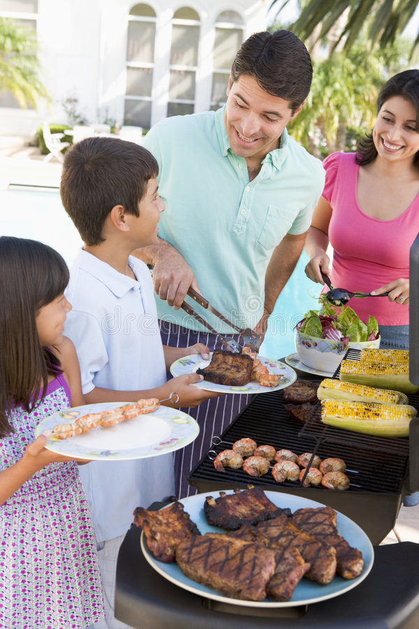 Download Family Enjoying A Barbeque Royalty Free Stock Photos - Image: 7230398