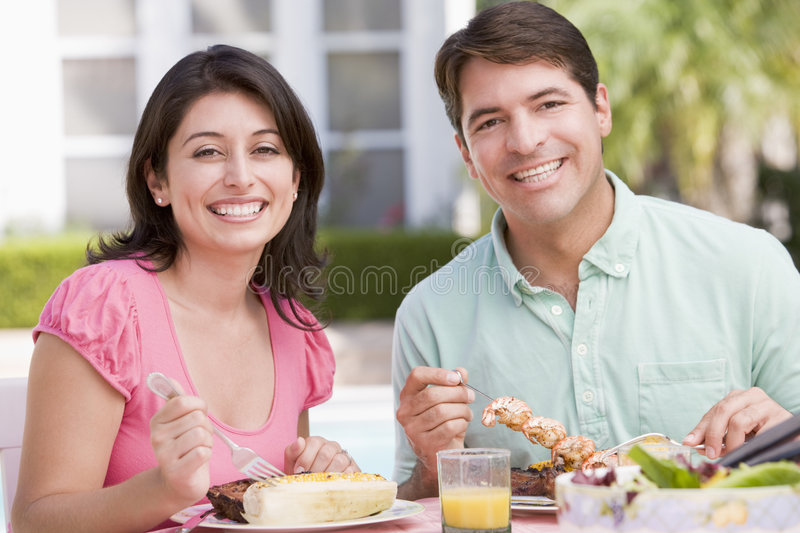 Family Enjoying A Barbeque stock photography