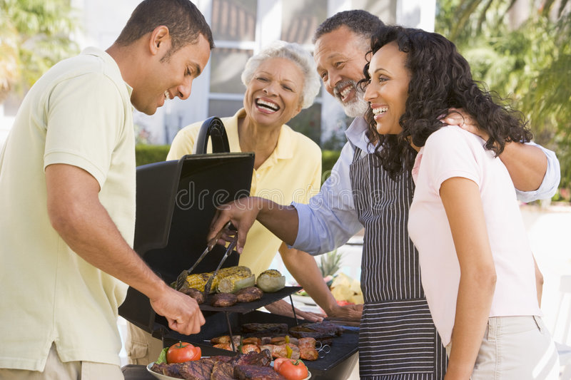 Download Family Enjoying A Barbeque stock photo. Image of couple - 7230570