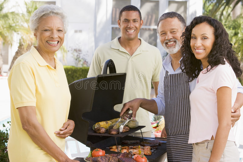 Download Family Enjoying A Barbeque stock photo. Image of group - 7230580