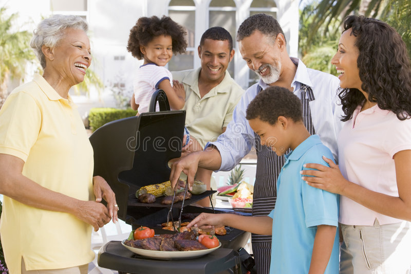 Family Enjoying A Barbeque Royalty Free Stock Photo
