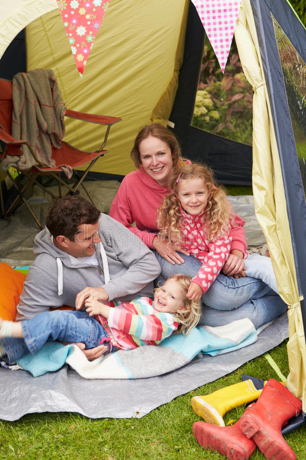 Family Enjoying Camping Holiday On Campsite. Smiling stock photo