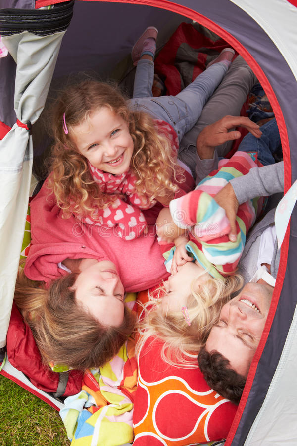 Family Enjoying Camping Holiday On Campsite stock images