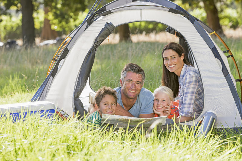 Family Enjoying Camping Holiday In Countryside royalty free stock images