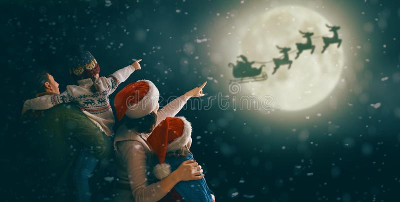 Family enjoying Christmas stock photos
