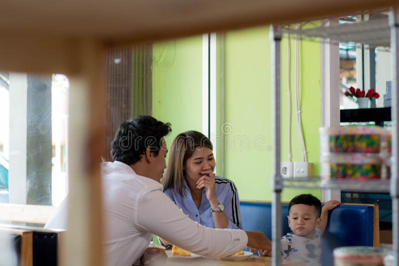 Potrait of asian family sitting inside  enjoying the day at cafe in the morning stock images