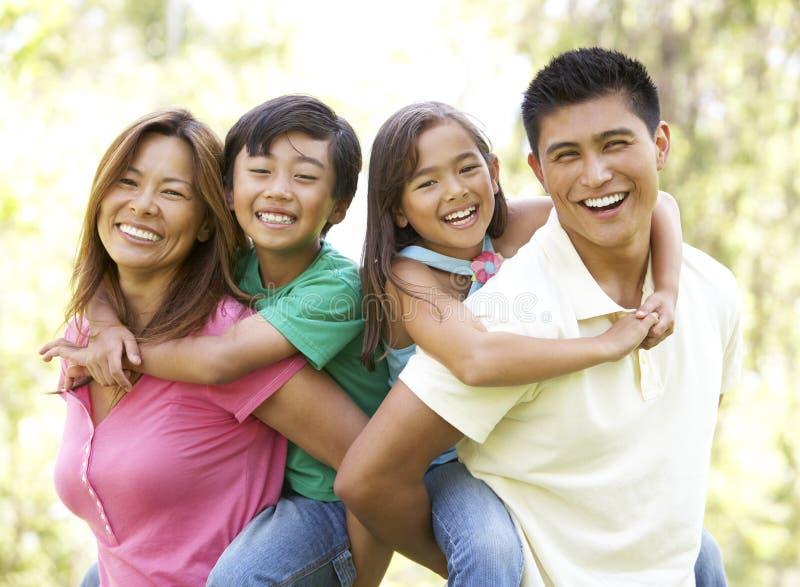 Family Enjoying Day In Park stock image