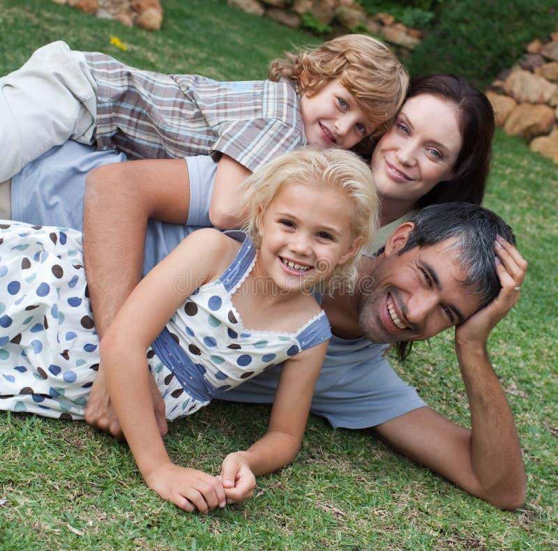 Family enjoying life in the garden stock photography