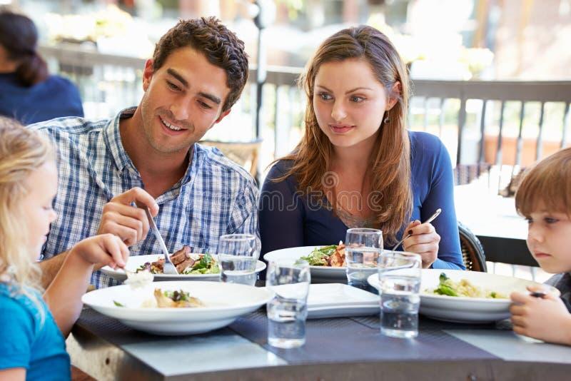 Family Enjoying Meal At Outdoor Restaurant. Smiling stock photos