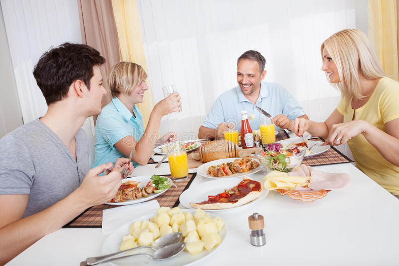 Download Family Enjoying A Meal Together Stock Image - Image: 27330845