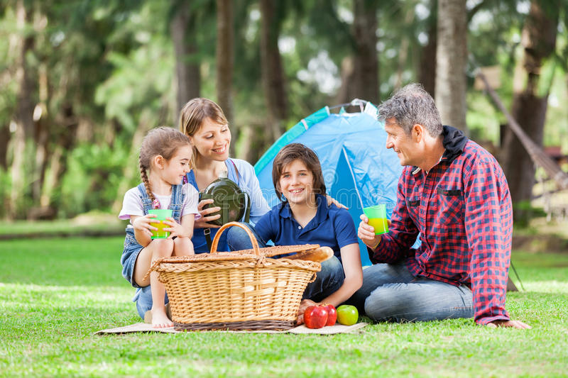 Family Enjoying Picnic At Campsite stock photography
