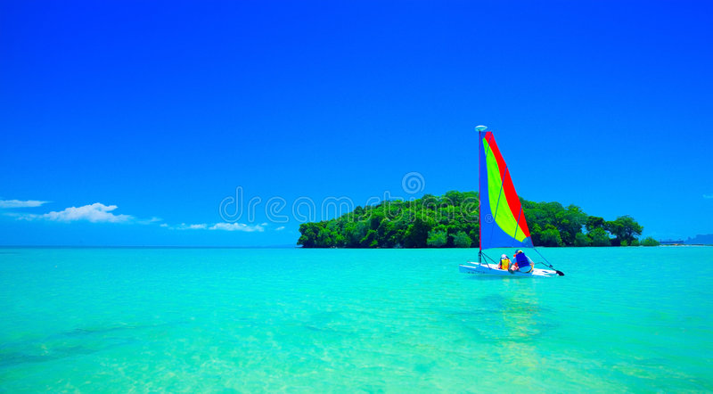 Family enjoying a ride in the sailboat royalty free stock photography