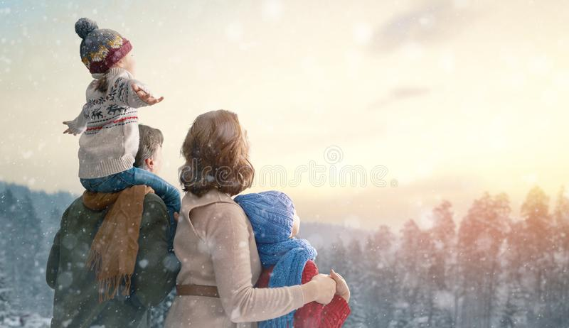 Family are enjoying  snowy winter nature stock image