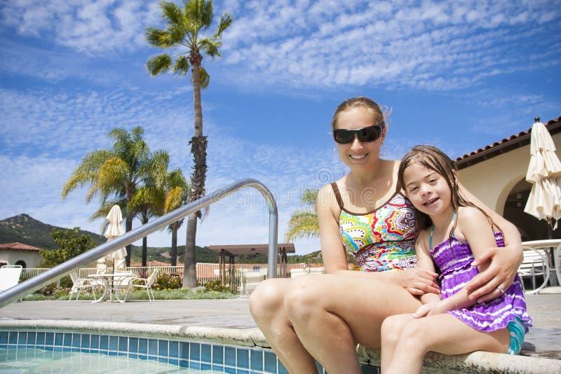 Family enjoying the swimming Pool stock photo