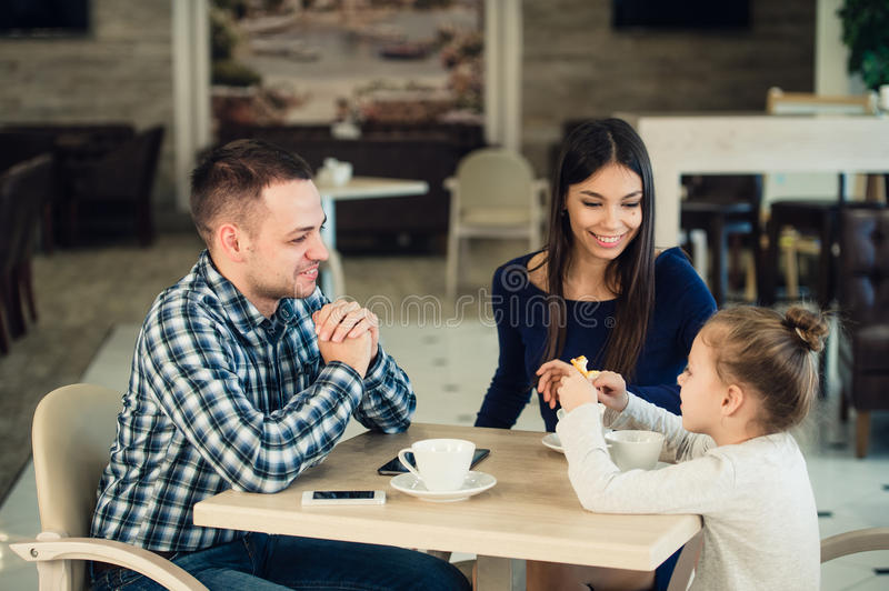 Family Enjoying tea In Cafe Together. Happy family Enjoying tea In Cafe Together stock photography