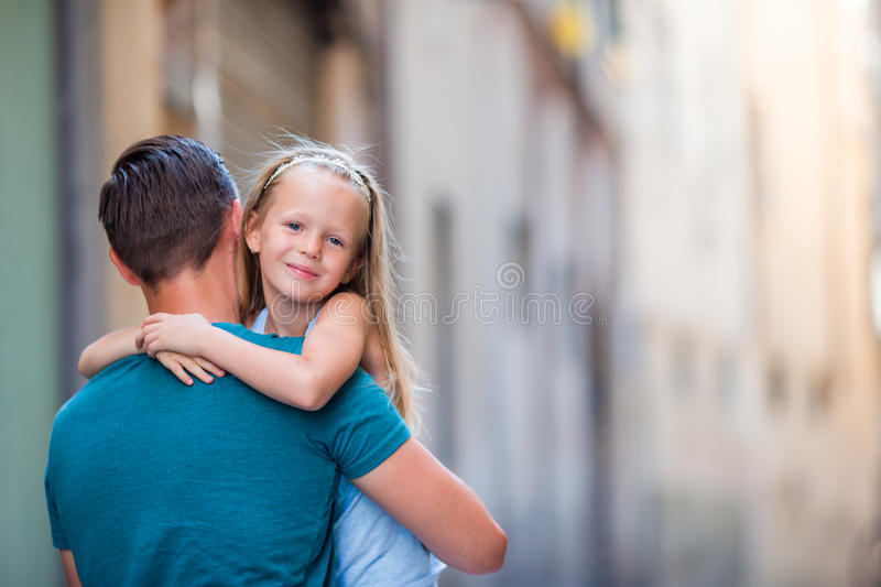 Family in Europe. Happy father and little adorable girl in old city during summer italian vacation stock images