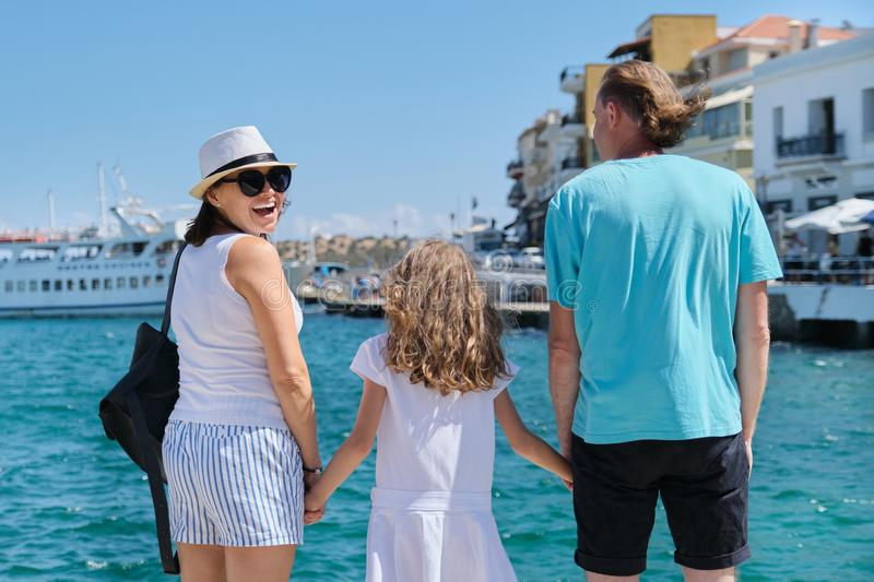 Family Europe tourist travel sea cruise vacation, back view stock image