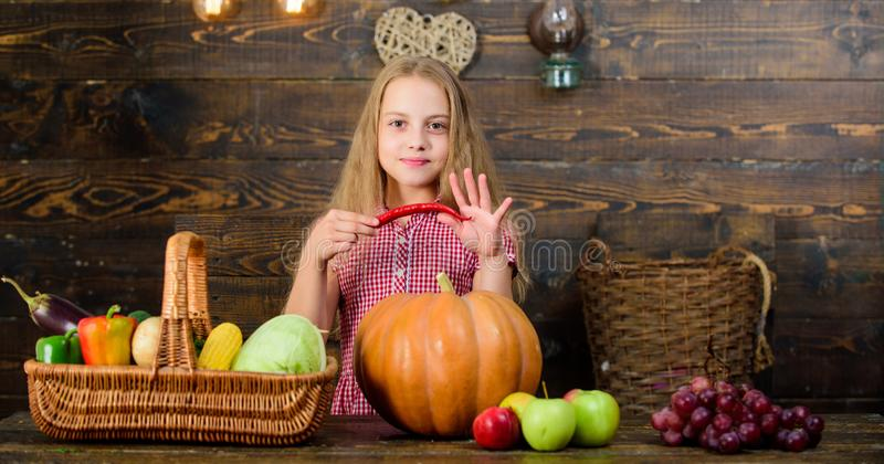 Family farm festival concept. Farm themed games and activities for kids. Girl kid at farm market with fall harvest. Child little girl celebrate harvesting. Kid stock photo