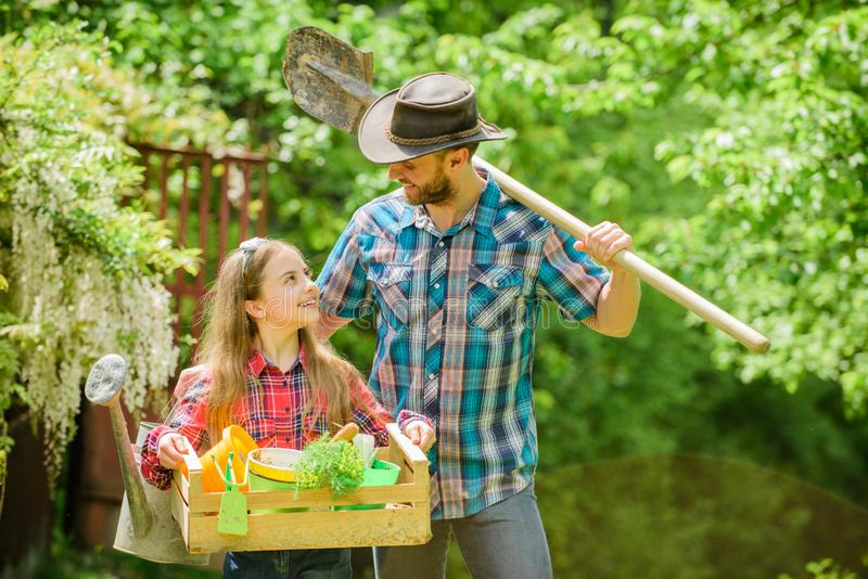 Family farm. summer farm. spring village country. ecology. Gardening tools. little girl and happy man dad. earth day royalty free stock photo