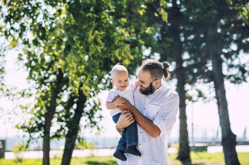 Family father and baby happy and beautiful with smiles together royalty free stock images