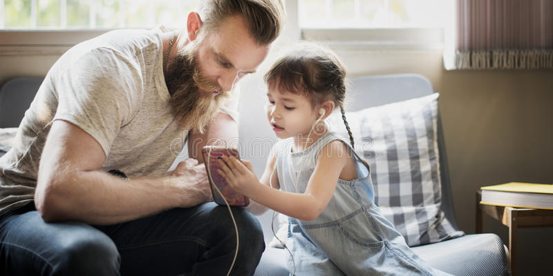 Family Father Daughter Love Parenting Listening Music Togetherness Concept stock photo