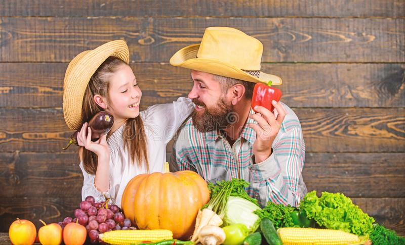 Family father farmer gardener with daughter near harvest vegetables. Countryside family lifestyle. Farm market with fall stock image