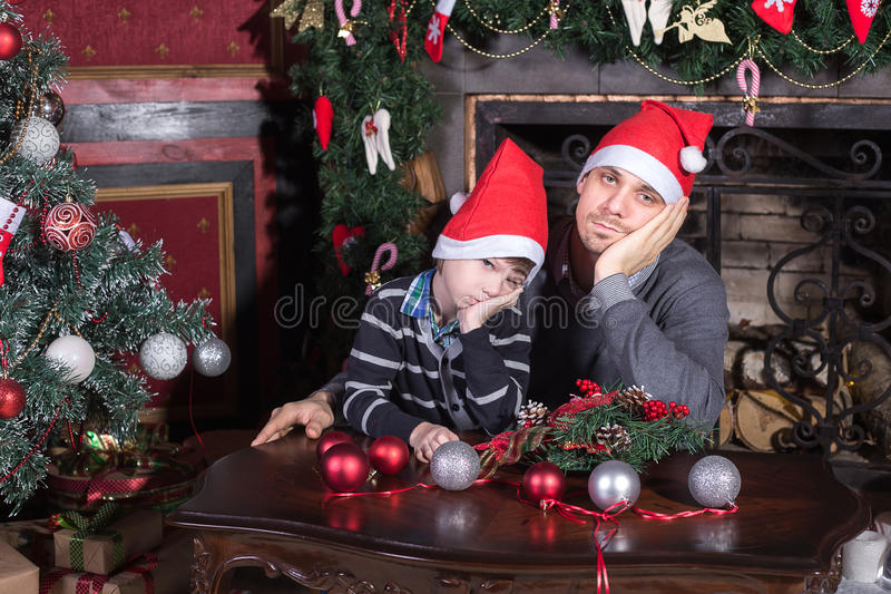 Family father and son sad on Christmas eve. royalty free stock photography