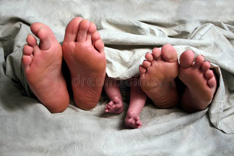 Family Feet. A family displays their feet at a photo session