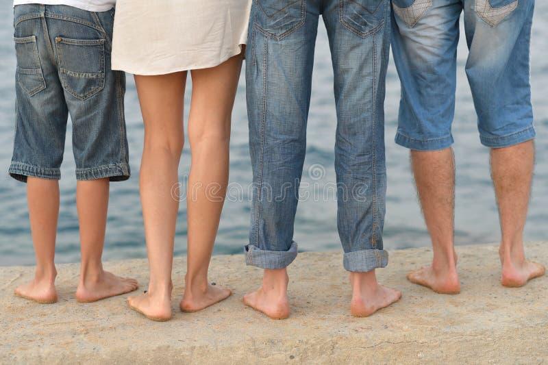 Family feet on beach royalty free stock photography