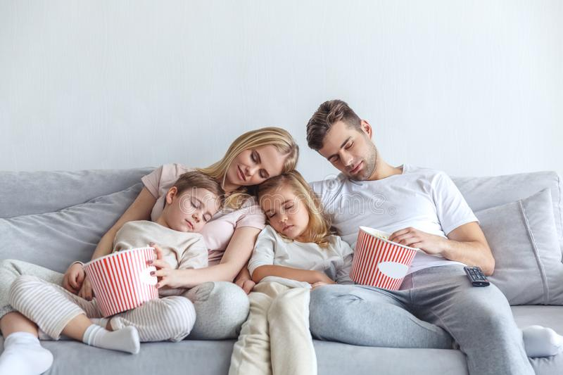 Family fell a sleep while watch movie. At home royalty free stock image