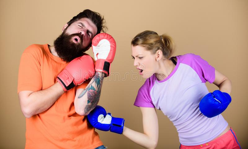 Family fight. knockout and energy. couple training in boxing gloves. training with coach. Happy woman and bearded man. Family fight. knockout and energy. couple royalty free stock photos